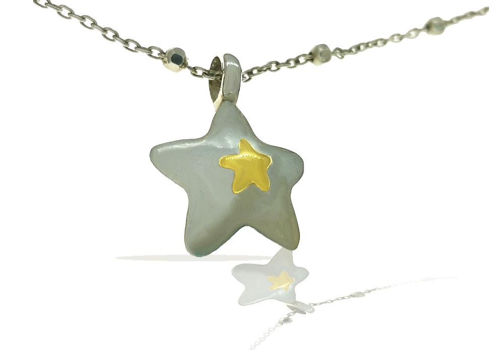 Colgante estrella plata Ixora